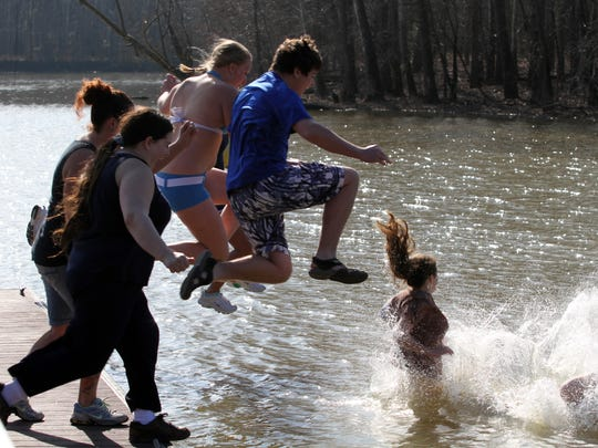 About 40 brave people dove into chilly Cumberland River waters on New Year's Day to help Stewart County Meals on Wheels at the annual Freezin' for a Reason.