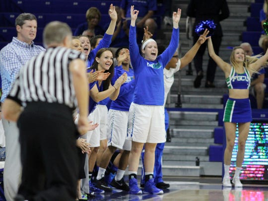 The FGCU bench celebrates one of Taylor Gradinjan's 3-pointers during FGCU's game against Stetson on Saturday night.