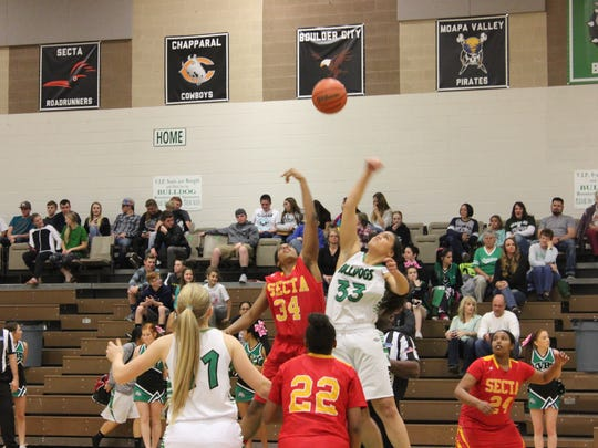 Virgin Valley's Bernice Fiso controls the opening tip against Tech on Thursday night.