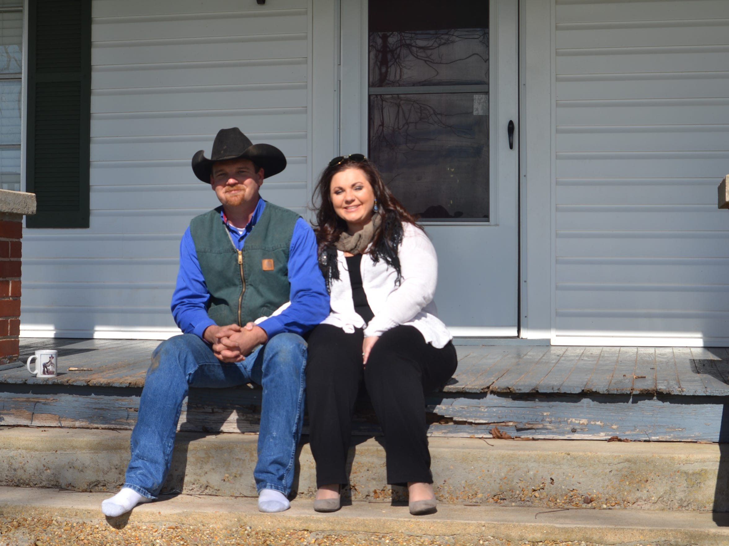 Ryan and Daniel Yerby sit on the porch of their farmhouse in Grant Parish. Despite knowing the challenges, the Yerbys have taken up the family mantle as farmers.