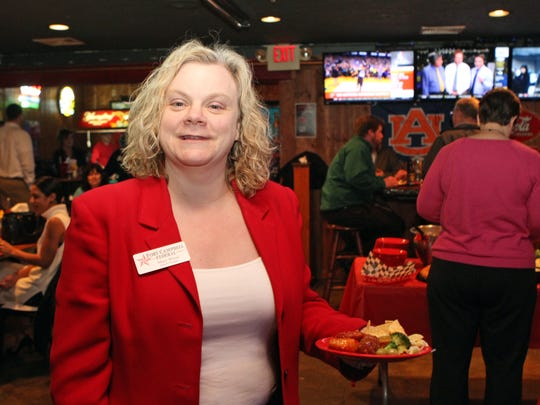 Fort Campbell Credit Union's Mary Wood was one of the large crowd of Chamber of Commerce members at February's Business After Hours which was held at Overtime Sports Bar & Grill Thursday.