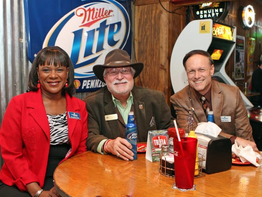 From left, Margaret Chase, Wayne Oldham and Randy Butler participate in the February Chamber of Commerce Business After Hours was held at Overtime Sports Bar & Grill Thursday afternoon.
