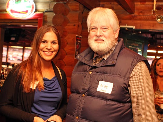 MSC Insurance agent Andy Hollis, right, and Heather Mayweather network at Overtime Sports Bar & Grill Thursday for Business After Hours