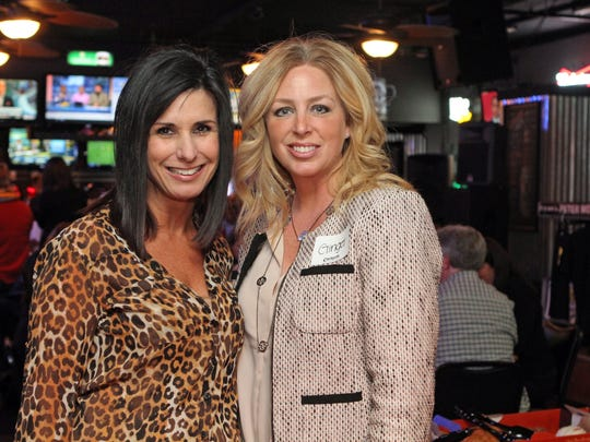 Yvonne Pickering, left, and Ginger Lawler attend  February's Chamber of Commerce Business After Hours, which was hosted by Overtime Sports Bar & Grill Thursday.
