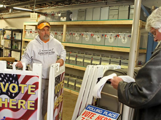 Charles Smith and Jeff Broome work to deliver voting materials to precincts Thursday.