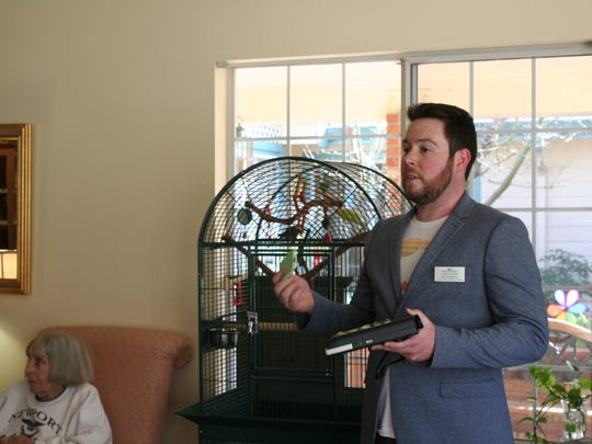 Joel Henderson shows a digital player and cartridge during his presentation of the State of Oregon's program Talking Books at Woodland Residential Inn on February 25.