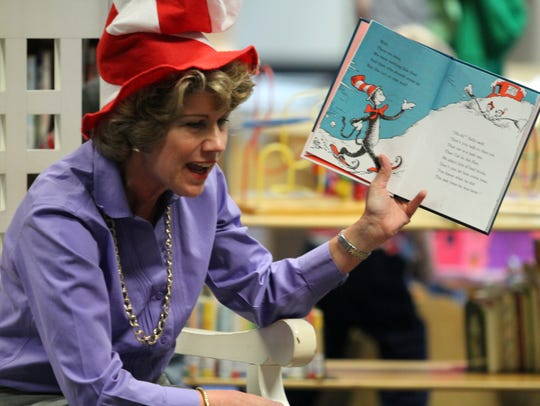 "Mayor Kim McMillan dressed the part to read ""The Cat"