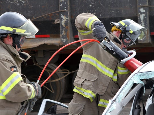 Firefighters Chase Clinard, left, and Kevin Douglas