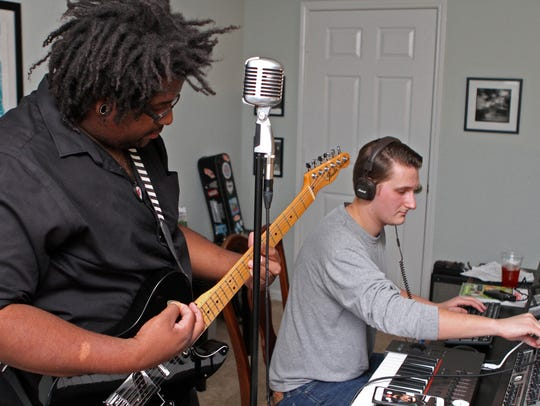 Local musician Rufus Dawkins, left, working with Layne