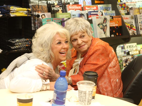 "Obera Williard, right, exchanged stories and got a hug from Paula Deen, left, Thursday at a book-signing for ""Paula Deen Cuts the Fat."""