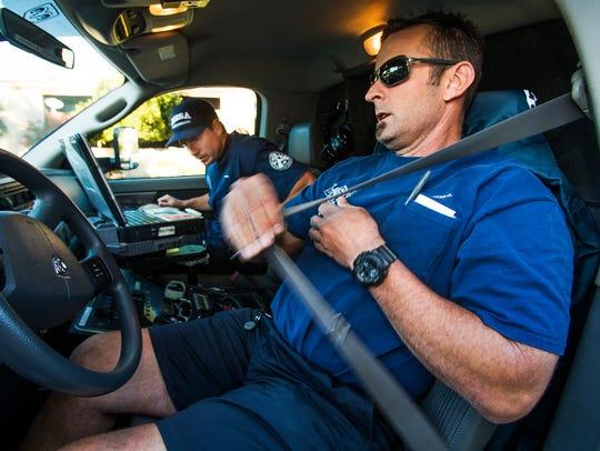 Mesa Fire paradmedics Rob Alkire (back) and Brian Davy