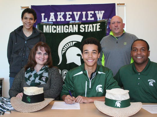 Lakeview's Andrew Walker signed his National Letter of Intent in Novemeber of 2015 to play golf at Michigan State University. He is joined by his parents, Nancy and Filmore Walker, along with his brother, Darius, and Lakeview coach Tony Evans.