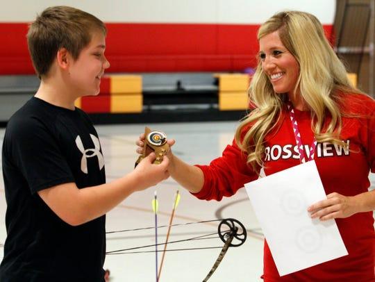 Rossview's archery program coordinator Briana Petersen