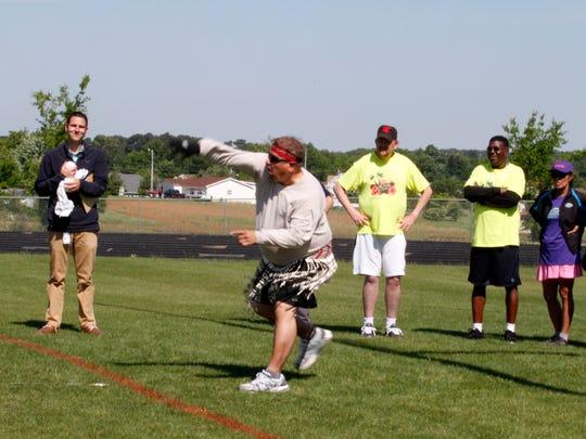 Ivan Adames takes on the softball throw in Polynesian Maori Warrior attire at this week's 50+ Olympics.