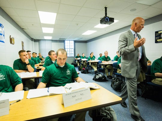 An instructor at the Delaware Technical Community College teaches law enforcement students about how to be a police officer. Enrollment in the college's Law Enforcement Option has not filled its capacity for 50 students since its inaugural year in 2013.