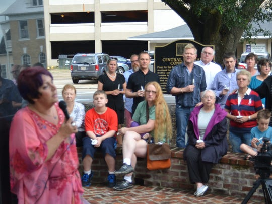 Ann Lowrey, executive director of Central Louisiana AIDS Support Services, speaks at a ceremony Monday night in remembrance of the victims of the recent mass shooting in Orlando, Florida.