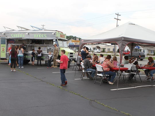 Six members of the Clarksville Food Truck Association