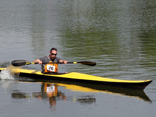Tim Schramm, last year's defending champion, pictured, came in 1st at 40:39, Mark Snider in 2nd at 46:42 and Lucas Chambers in 3rd at 50:11. They were the top three finishers in Saturday's individual kayak competition.