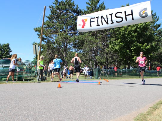 2015 participants cross the finish line for the triathlon.