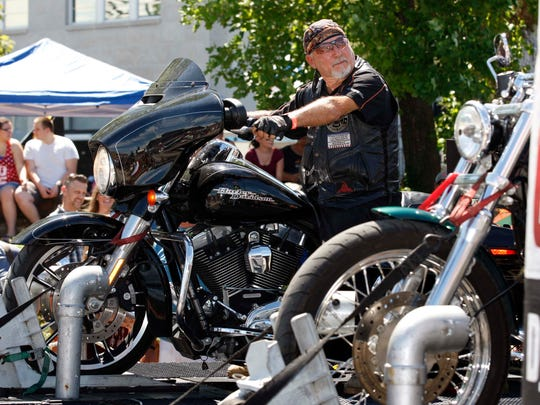 Denny Prothro races his Harley on the Dyno Drag Race at the Route 66 festival in downtown Springfield on August 13, 2016.