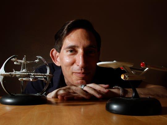 """Roger Fachini II, a longtime """"Star Trek"""" fan, poses"""