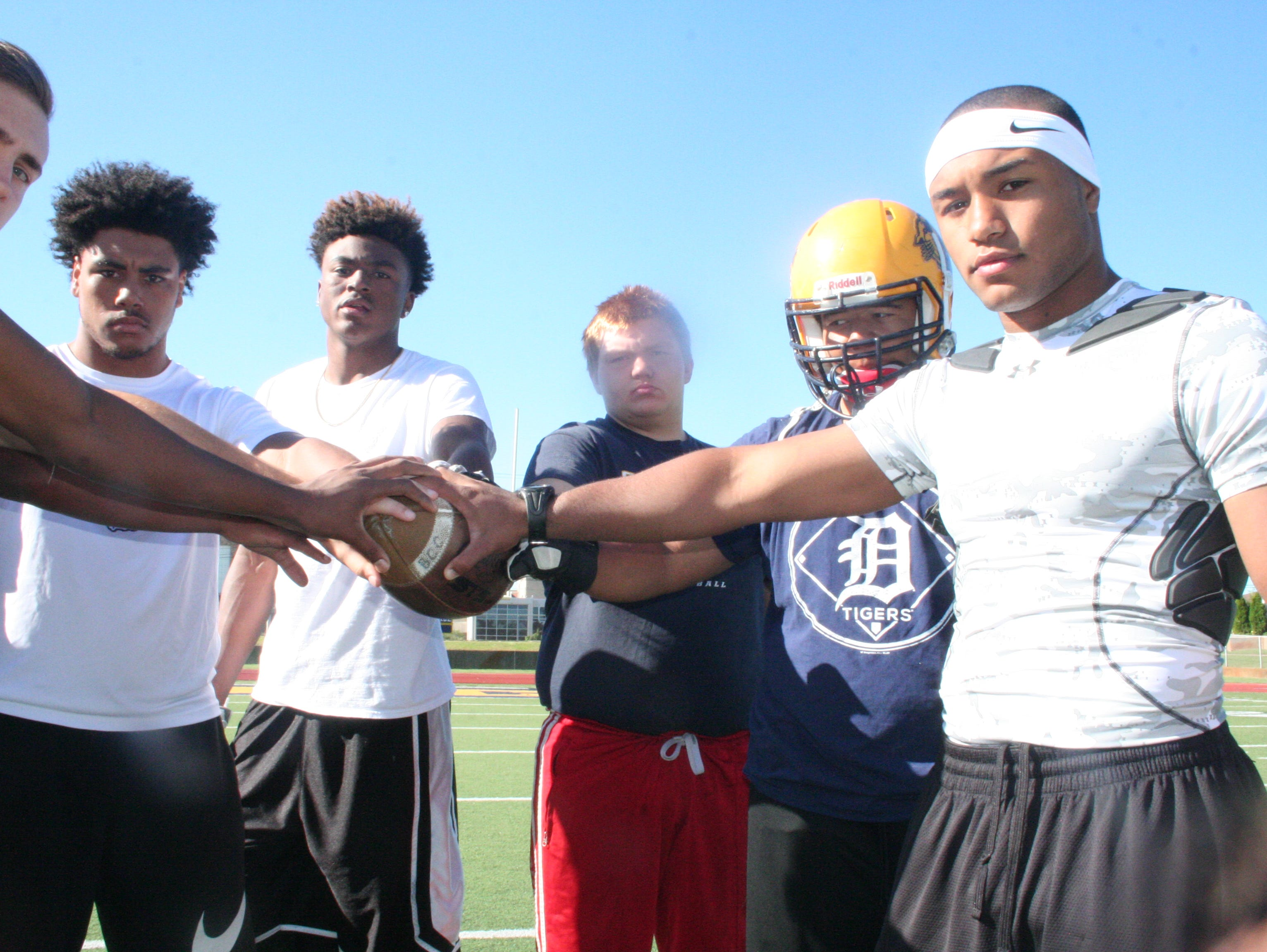 Battle Creek Central's Carlos Park, right, has returned to the team after serving his country in U.S. Army boot camp.