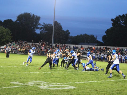 Brant Bohman battles for more yardage Friday night