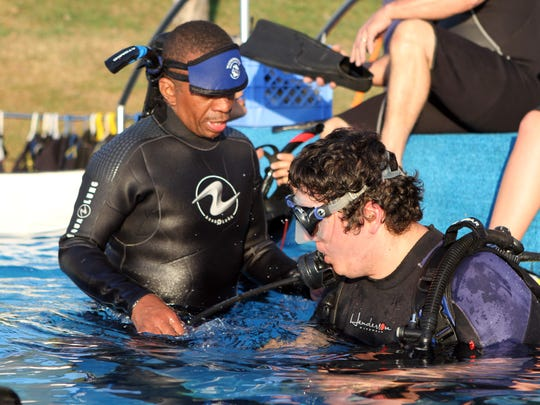 Fitz Dickson, left, a dive master with Waterdogs Scuba