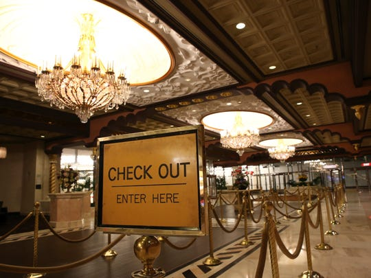 A sign is seen in the empty lobby at the closing Trump Taj Mahal early Monday.
