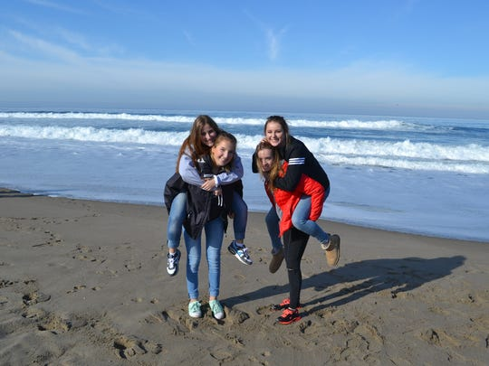 German students Melin Grosse, Linda Immig, Lisa Temma and Melina Timm have a bit of fun on the beach.