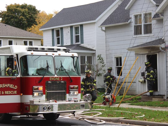 Crews respond to fire at 202 W. Arnold St., Friday, Oct. 14, 2016.