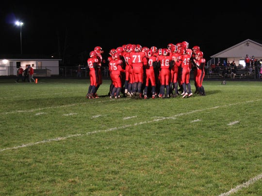 Spencer/Columbus Catholic jumps around before kickoff of   a WIAA Division 5 Level 1 playoff football game against Bonduel.