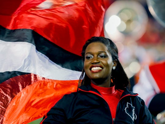 The U of L color guard's Alyesse Coonrod says 'When I'm on the field I like to free my mind so i don't get distracted with the outside world and to keep down my nerves down but to also keep my head up and a smile!'  Nov. 12, 2016