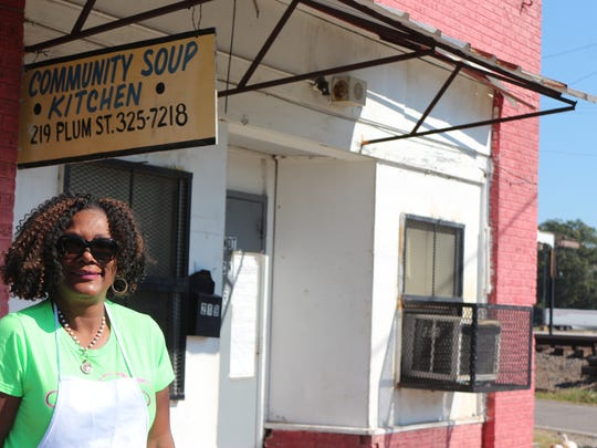 Shereba Diaz in front of Granny Goins Community Soup Kitchen, where she volunteers.