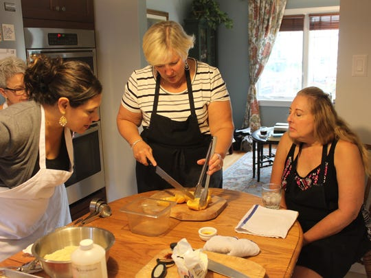 Angela Ranalli-Cicala (left) leads a baking class for Theresa Selover of  Marlton and her friends in Selover's kitchen. Ranalli-Cicala grew up in the home.