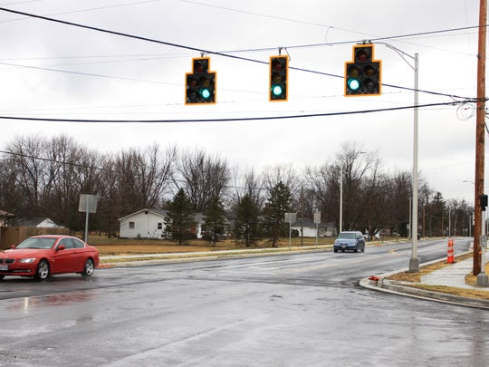 This is what the Taylor Road and Palmer Road intersection looks like now, after work crews added sidewalks, traffic lights and turn lanes. The rest of the project is slated to be finished this spring.