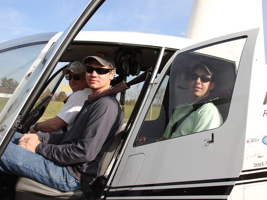 Fourth Year Apprentice Tyler Miller, left and Journeyman First Class Craig Mummert prepare for take-off during 2016 aerial patrols of Adams Electric lines with pilot Dan Lipko of Pine Bottom Aviation.