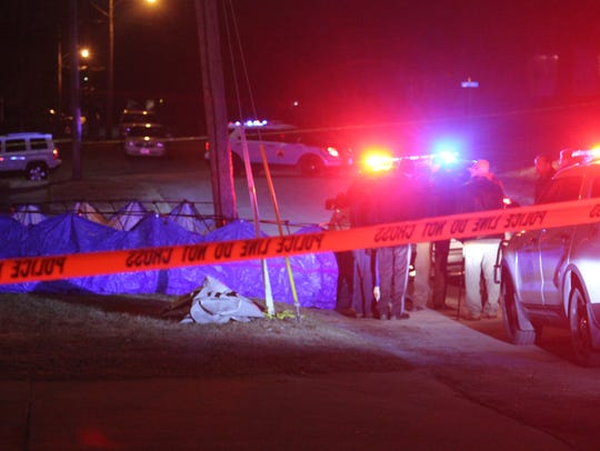 Des Moines police investigate the scene where a shooting