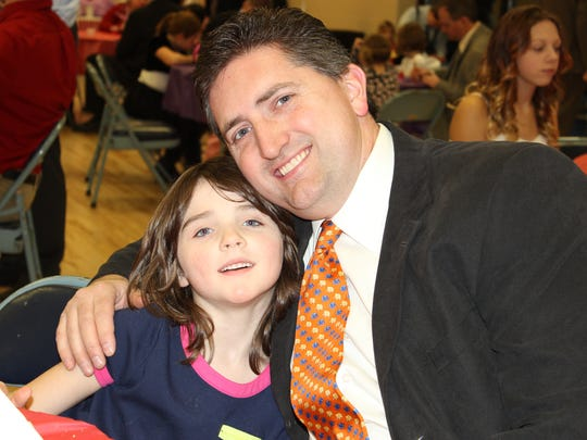 Corinne Rhoden, at left, and her father, Jerry, at right, attended The Woodson YMCA's 26th annual Father/Daughter Dance in February. It was a very special daddy/daughter evening at the Woodson YMCA-Wausau Branch. Hundreds of fathers brought their daughters out for a night of dancing, crafts and treats. Event tickets and raffles last year raised $22,333 for the Y's Annual Community Partners Campaign so that kids and families in need may experience YMCA programs and reduced fee memberships.