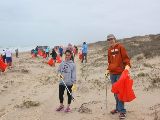 Wayde Adler, on right, has recruited friends to as volunteers for the Big Shell Beach Cleanup for several years.