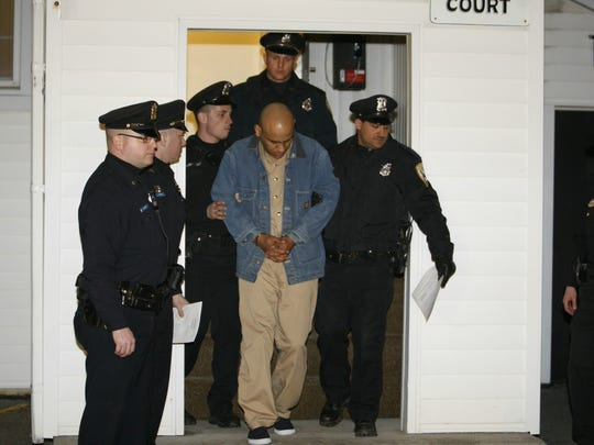 Frank Garcia being led out of Sweden Town Court in 2009.