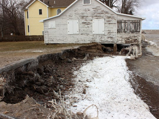 Soil below this Hamlin cottage, which was not protected by a breakwall or riprap, was eroded away by waves during the March windstorm.