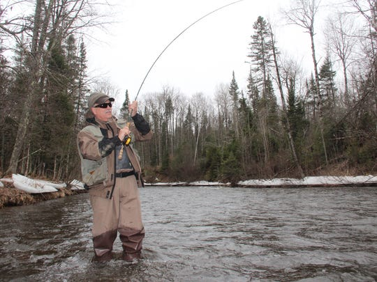 Dave Zeug of Shell Lake fights a steelhead on the Brule River in northern Wisconsin during a previous season.