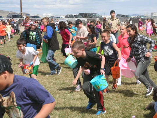 Children rush to collect Easter eggs at the annual