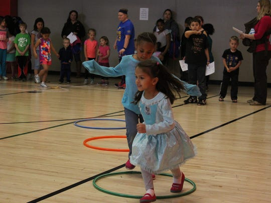 Children play in the gym at the Woodson YMCA's Aspirus