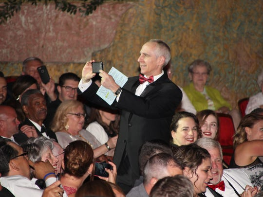 Marion Community Foundation president and CEO Dean Jacob has some fun with the crowd during the Celebrate Marion gala.