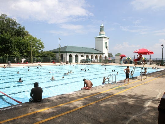Swimmers enjoy a hot summer afternoon in the pool at