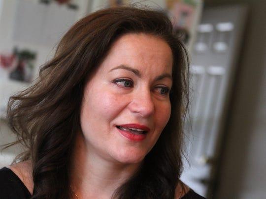 Joanie Maciak, of Brighton, grew emotional and teary-eyed