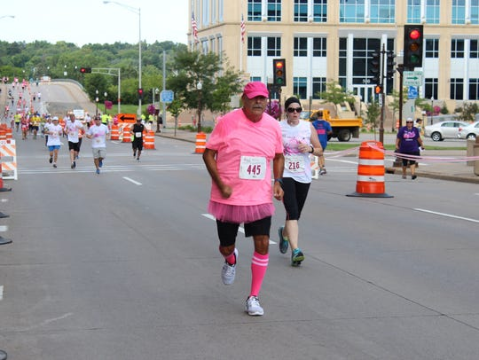 Bill Wasmund of Wausau nears the finish line at the