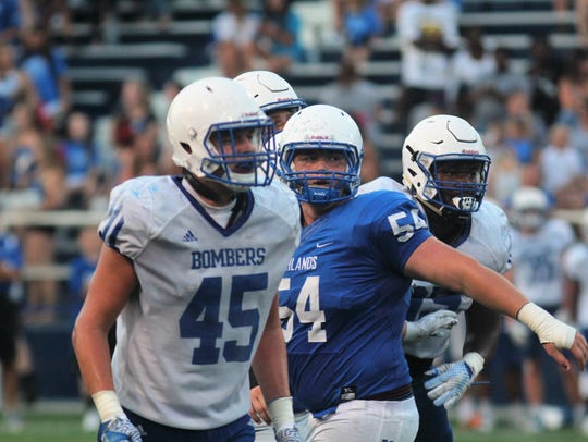 St. Xavier junior DL Thomas Kiessling looks for the
